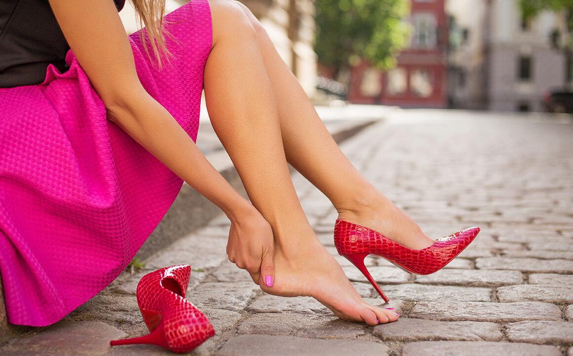 reasons-to-consider-shoe-repair-woman-rubbing-hurt-foot-main-image-shoes-feet