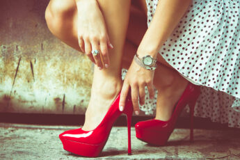 stay-fashionable-and-trendy-on-a-budget-woman-touching-her-red-shoes