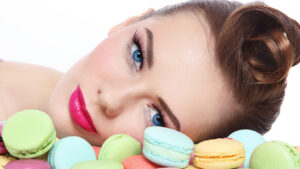 ways-to=look-more-youthful-without-surgery-woman-looking-at-colorful-macaroons
