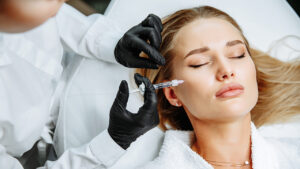 current-plastic-surgery-trends-less-is-more-woman-getting-injection